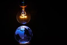 Light bulb and earth Stock Photography