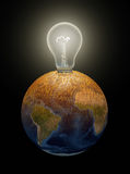 Light bulb in Earth Stock Photos