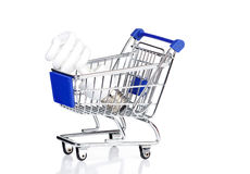 Light Bulb: Energy Saving Bulb. In a Shopping Cart isolated on White Background royalty free stock photo