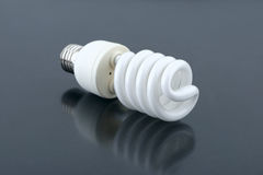 Light bulb. Energy saving fluorescent light bulb over grey background Stock Photo