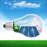 Light bulb energy. Light bulb with solar panels Royalty Free Stock Images