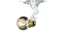 A light bulb falling in water Royalty Free Stock Photo