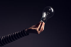 Light bulb in female hand Royalty Free Stock Photo