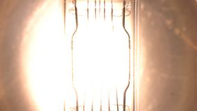 Light bulb filament glow slow flashing tungsten lightbulb. Floodlight flashes.  stock video footage