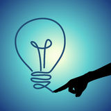 Light bulb on fingertip. Conceptual idea selection after intense brainstorming Royalty Free Stock Image