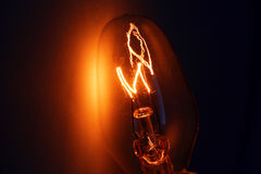 Light bulb on fire. Light bulb a blaze at night Stock Photos