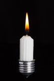 Light bulb fitting with no glass and candle Stock Photo