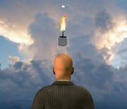 Light Bulb with Flame. Above Man Stock Photos