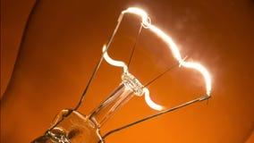Light bulb flickering stock video footage