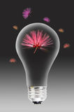 Light bulb with flowers Stock Images