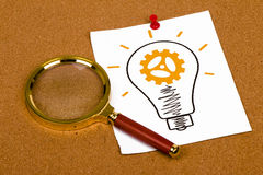Light bulb with gear Royalty Free Stock Photos
