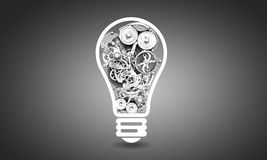 Light bulb with gears Stock Images