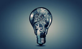 Light bulb with gears. Conceptual image with light bulb filled with gears Royalty Free Stock Image