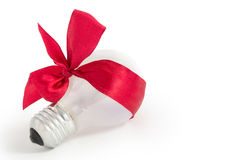 Light bulb gift with red ribbon. Isolated Royalty Free Stock Photos