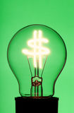 Light bulb with glowing dollar symbol Royalty Free Stock Images