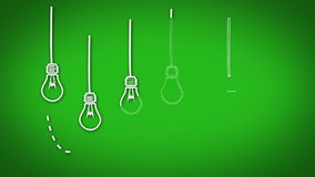 Light bulb graphics appearing in row on green background Stock Image