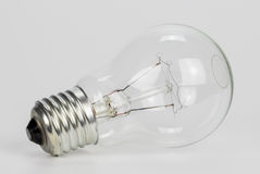 Light bulb on a gray background Royalty Free Stock Image