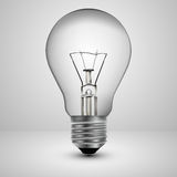 Light bulb on a gray background Royalty Free Stock Photos