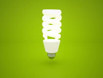 Light bulb  on green background Royalty Free Stock Photo