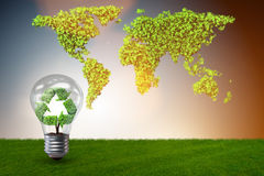 The light bulb in green environment concept - 3d rendering Royalty Free Stock Photo