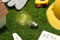 Light bulb on green natural background , green energy concept Royalty Free Stock Photos