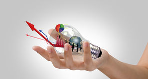 Light bulb in hand Royalty Free Stock Image