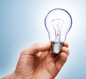 Light bulb in hand Royalty Free Stock Photo