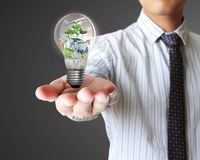 Light bulb in hand Stock Photo