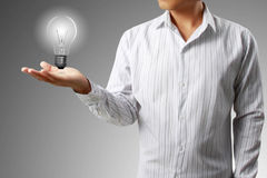 Light bulb in a hand Stock Photo