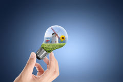 Light bulb on a hand Royalty Free Stock Image