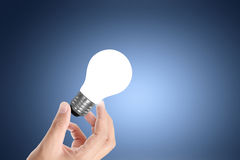 Light bulb on a hand Royalty Free Stock Photo