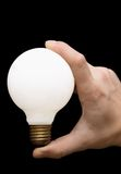 A light Bulb in a hand. Hand holding isolated light bulb Royalty Free Stock Photography