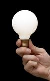 A light bulb in a hand. Hand holding isolated light bulb Stock Photos