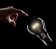 Light bulb with hand Stock Photo
