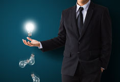 Light bulb in hand. Light bulb in business hand Royalty Free Stock Photo