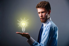 Light bulb in hand businessman Royalty Free Stock Photos