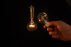 Light bulb and hand Stock Photography