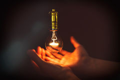 Light bulb and hand Stock Photo