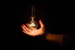 Light bulb and hand Royalty Free Stock Images