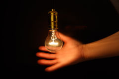 Light bulb and hand Royalty Free Stock Photo