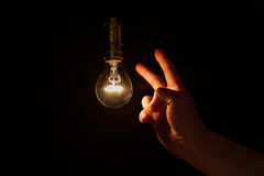 Light bulb and hand Royalty Free Stock Photography
