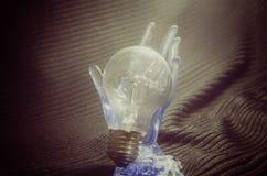 Light bulb in hand. Stock Image