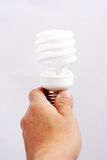 Light bulb in a hand isolated on white background Royalty Free Stock Photo