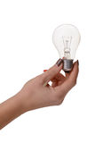 Light bulb in a hand on a white background Stock Images