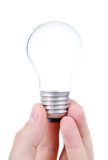 Light bulb in hands Royalty Free Stock Image