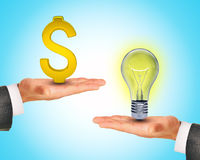 Light bulb in hands with dollar sign Stock Photo