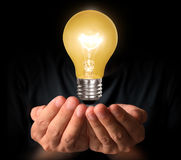 Light bulb  in hands Royalty Free Stock Photo