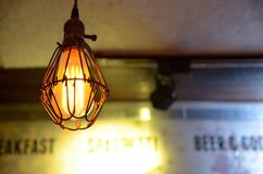 Light bulb. A light bulb hanging in the nightclub Stock Photography