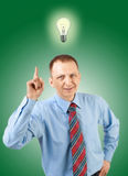 Light bulb hanging over businessman's head Stock Photography