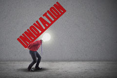 Light bulb head carry innovation. Light bulb head is carrying the word innovation Stock Image
